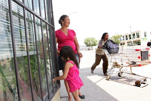 Althea Guiboche, also known as the Bannock Lady, stands near the corner where she hands out free bannock  weekly (Dufferin & Main) with her children after talking to the media about her views on the recent Facebook posting scandal.  WIth her daughter Aralynn (3yrs). See story.  WIth her daughter Aralynn (3yrs). Aug 09, 2014 Ruth Bonneville / Winnipeg Free Press