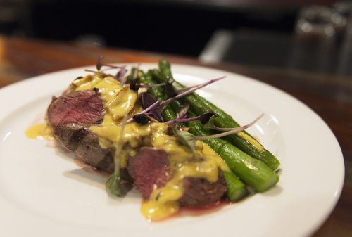 Beef with lobster mushroom cream sauce with potatoes and asparagus at Food Evolution. Sarah Taylor / Winnipeg Free Press August 19, 2014