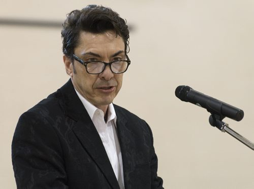 Michel Fillion speaks at Sisler High School Tuesday night as Manitoba Filipino Business Council confirms eight out of nine mayoral candidates. Sarah Taylor / Winnipeg Free Press August 26, 2014