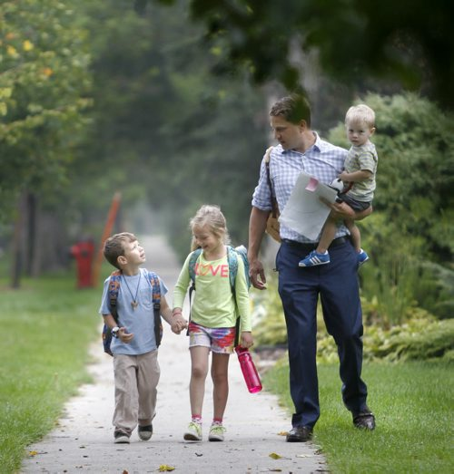 Tuesday was the first day of school for Isaak,4, going into kindergarten and his sister Ava,6, starting grade 2 at Robert H. Smith School with their dad Kirk Johnson holding younger brother Oliver. Wayne Glowacki/Winnipeg Free Press Sept.3 2014