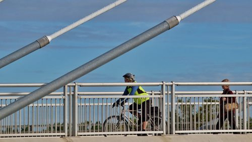 A cyclist makes her way over the Esplanade Riel Tuesday morning.  140901 September 09, 2014 Mike Deal / Winnipeg Free Press