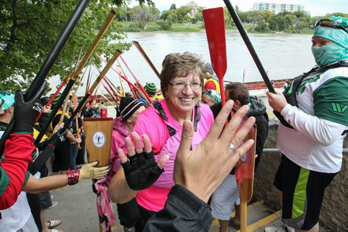 Cancer survivor Helen Lewandoski gets a high-five after a race while other paddlers pay their respects by forming a tunnel with their paddles during the Manitoba Dragon Boat Festival in support of CancerCare Manitoba and the Children's Hospital Foundation of Manitoba at The Forks Sunday.  130914 - Sunday, September 14, 2013 -  (MIKE DEAL / WINNIPEG FREE PRESS)
