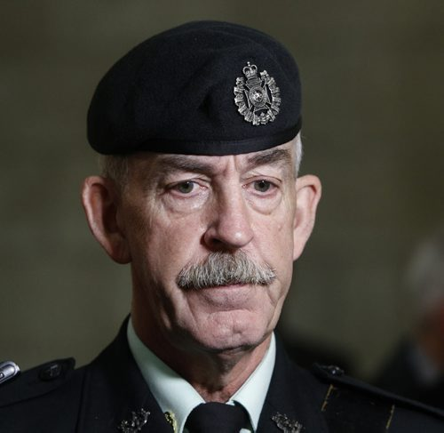 Chief Warrant Officer Jim Seggie, whose son Michael, 21, was killed in a firefight with the Taliban in 2008 talks to media after the ceremony to open the Afghanistan Memorial Vigil a memorial to Canada's 12-year military deployment now on display at the Manitoba Legislative Building.Larry Kusch story Wayne Glowacki/Winnipeg Free Press Sept.16  2014