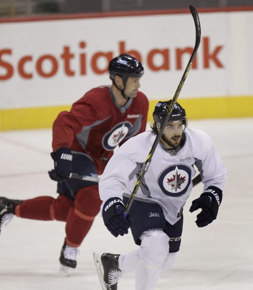 At right Winnipeg Jets centre #85 Mathieu Perreault at the team practice in the MTS Centre Thursday. Tim Campbell  Story.Wayne Glowacki / Winnipeg Free Press Oct.16 2014