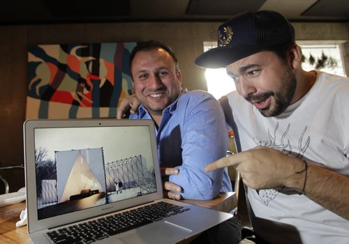 At right is Mandel Hitzer  with Joe Kalturnyk are co-directors of RAW:almond with an image of the RAW:almond 2015 winning  design by UK architects OS31. There's going to be a different look and feel to the restaurant on the river this coming January Geoff Kirbyson story Wayne Glowacki/Winnipeg Free Press Oct.23  2014