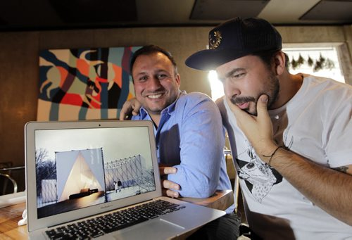 At right is Mandel Hitzer  with Joe Kalturnyk are co-directors of RAW:almond with an image of the RAW:almond 2015 winning  design by UK architects OS31. There's going to be a different look and feel to the restaurant on the river this coming January. Geoff Kirbyson story Wayne Glowacki/Winnipeg Free Press Oct.23  2014
