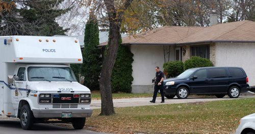 Winnipeg police are now searching the house and garage of Andrea Giesbrecht's home in the Maples. A large van with the WPS's Identification Unit, or forensics team, is backed up to the garage of the home. Another van is parked in front, and there are about six police vehicles on the street as well. 141029 - Wednesday, October 29, 2014 -  MIKE DEAL / WINNIPEG FREE PRESS