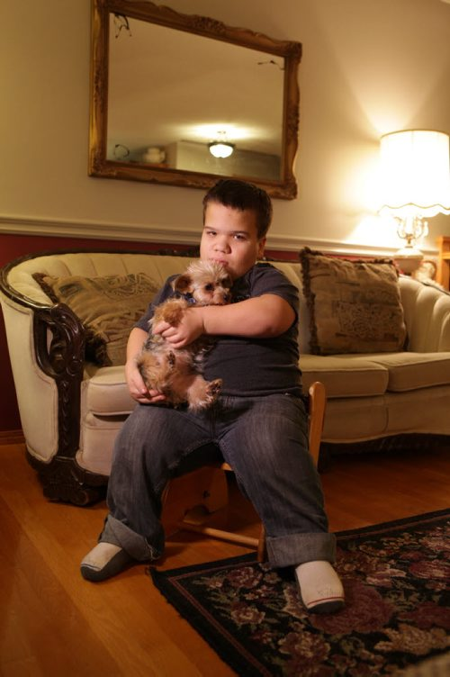 Sixteen year old David holds and plays with his little dog Cole at home.  Lisa Funk's son David is a dwarf, family is filing a human rights complaint for the way he's allegedly treated at school in River East Transcona School Division and for the services the division is not providing for him.   Nov 6,  2014 Ruth Bonneville / Winnipeg Free Press