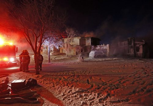 LOCAL. House fire St. Norbert . A fire that apparently started in an attached garage did heavy damage to the home and winds  spread the fire  to the roof of the  house next door .The fire started around 5am on Payment ST. off of Grandmont Blvd. NOV. 26 2014 / KEN GIGLIOTTI / WINNIPEG FREE PRESS