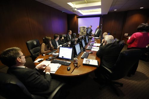 LOCAL - city councillors at downtown development committee meeting at city hall listen to Left Jeff Pinchin  (holding photo)  with Chuck Chapell making presentation regarding  electronic sign in downtown area . Thursday, 9:30. Some general shots of the room and the meeting . Aldo Santin story . NOV. 27 2014 / KEN GIGLIOTTI / WINNIPEG FREE PRESS