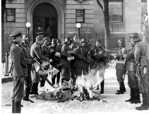 Winnipeg Free Press Archives If day -  Feb 20, 1942  Nazi troops burn books  during mock invasion.  Feb 20/42