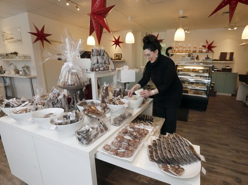 Sunday This City - Chocolatier Constance Popp .** note last name is different from company name.  Chocolatier Constance Popp, 180 Provencher Blvd. - In photo  owner Constance Menzies  for a Sunday This City spread on Menzies's St Boniface chocolate shop - a spot that has made a name for itself during the last 7 years, for its treats and creative designs, when it comes to chocolate. Christmas goodies available - chocolate in all shapes of trees, nutcrackers, etc - as well as a shot of Menzie's Human Rights Museum made out of chocolate - a creation that blew the museum's architect away, when Menzies presented him with one a few months Dec. 11 2014 / KEN GIGLIOTTI / WINNIPEG FREE PRESS