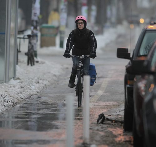 LOCAL - STANDUP - A cyclist speeds down Sherbrook Street in the mild Friday morning temperatures. NO NAME OF CYCLIST. BORIS MINKEVICH / WINNIPEG FREE PRESS December 12, 2014