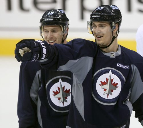 Winnipeg Jets  Mark Scheifele, right and teammate Bryan Little at morning practice Tuesday.- The Jets are in preparation for a home game tonight against the Buffalo Sabers- See Ed Tait story – Dec 16, 2014   (JOE BRYKSA / WINNIPEG FREE PRESS)