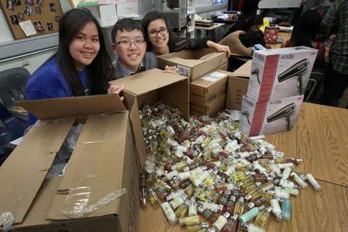 Sisler High school students collected  over 3500 items of person hygiene products for homeless at Siloam Mission- L to R- Gr 11 students Mae Anne Bathan, Calvin Loi, and Ashley Amaral- See Nick Martin Story – Dec 19, 2014   (JOE BRYKSA / WINNIPEG FREE PRESS)