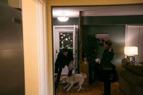 6:47:14 PM Brian arrives home and says hello to Indiana after picking up ugly sweater makings for his wife Tacey. 141215 - Monday, December 15, 2014 - (Melissa Tait / Winnipeg Free Press) Brian Bowman