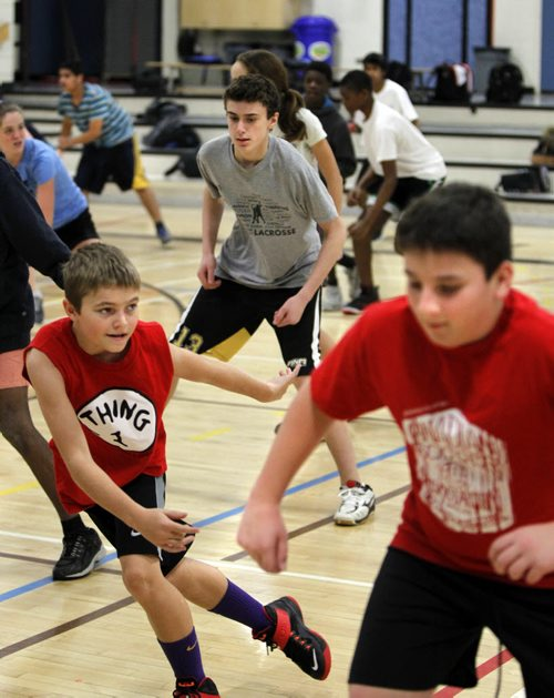 Acadia Junior High School students take part in warm up exercises in their gym class. Nick Martin story on Manitoba student health survey. / Wayne Glowacki Winnipeg Free Press Jan. 9 2015