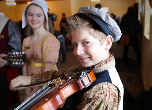 Twelve-year-old Miguel Sorin who's part of the family that have been picked to be ambassadors for this year's  Festival du Voyageur, plays the fiddle at the press conference while his older sister Amélie - 13yrs looks on.  Jan 13, 2015 Ruth Bonneville / Winnipeg Free Press