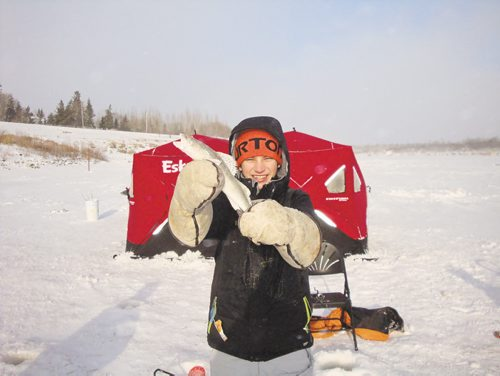 Canstar Community News Jan. 8, 2015 - Hudson Wall of River East Collegiate shows off a sauger he caught during the grade 9 outdoor education ice fishing trip to Lockport, Man.