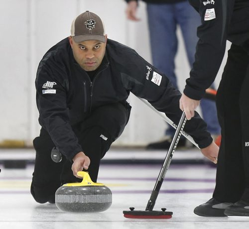 Stan Pierre on the team skipped by Kevin Brown throws rock in a game at the Assiniboine Memorial CC Friday. Stan is also the defensive coordinator for the UM Bisons football team.     Ed Tait story  Wayne Glowacki / Winnipeg Free Press ¤Jan. 16 2015