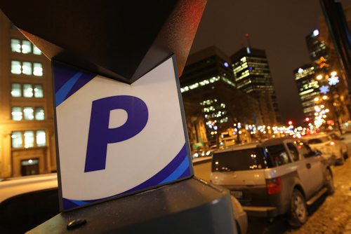 Photo illustration of parking meter for story on proposal for new paid parking during the evening hours in downtown Winnipeg.  Picture taken on Main street near the Concert Hall.  See Randy's story.  Jan 16, 2015 Ruth Bonneville / Winnipeg Free Press