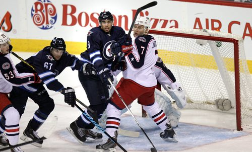 Winnipeg Jets Evander Kane and Michael Frolik work the empty net against Columbus Blue Jackets #53 Josh Anderson and #7 Jack Johnson in the first period at the MTS Center Wednesday. January 21, 2015 - (Phil Hossack / Winnipeg Free Press)