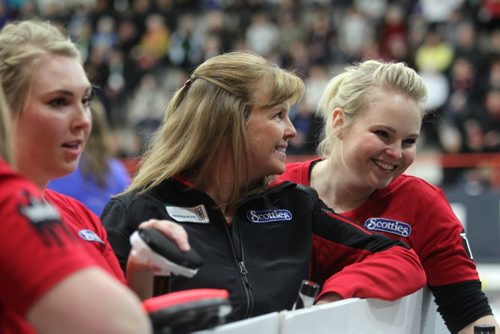 Sports, Curling. The Spencer team, Barb Spencer, second from right, Holly Spencer (right), Katie Spencer (left of Barb) and Aydney Arnal (not in photo) are all smiles after winning their game against Monfford 9 - 1 at Winkler Arena during the Scotties Tournament of Hearts Friday afternoon.   Jan 23, 2015 Ruth Bonneville / Winnipeg Free Press