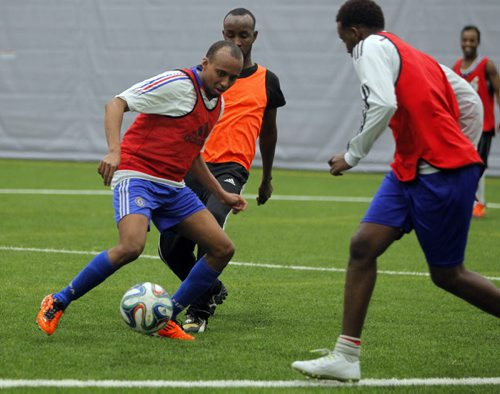 LOCAL - Newcomer men who meet every Friday night to play soccer and hang out with the guys so they're not as isolated and stressed. Here is some of the men playing some soccer. BORIS MINKEVICH / WINNIPEG FREE PRESS  JAN. 30, 2015