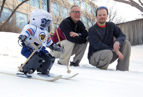 LOCAL - Jennifer, the first hockey-playing robot, was built at the University of Manitoba and featured on science TV shows. Now, she's taken to the slopes, although she's not ready for the black diamond runs. But maybe the bunny hill. Photo taken in behind the U of M Engineering faculty. Besides the robot, Computer Science prof. Jacky Baltes, who co-directs the autonomous agents lab,  and computer science graduate student Chris Iverach-Brereton. BORIS MINKEVICH / WINNIPEG FREE PRESS  FEB. 5, 2015