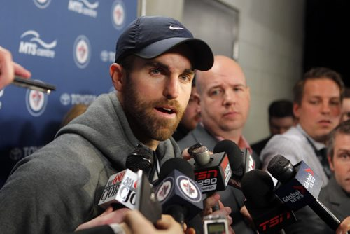 SPORTS - Winnipeg Jets Andrew Ladd talks to the media after the trade announcement by general manager Kevin Cheveldayoff at the MTS Centre. BORIS MINKEVICH / WINNIPEG FREE PRESS  FEB. 11, 2015