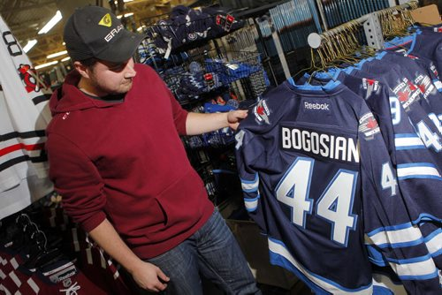 SPORTS - Royal Sports employee Casey Bresch with some Zach Bogosian and Evander Kane wear that is coincidently on sale at the Pembina Highway store. BORIS MINKEVICH / WINNIPEG FREE PRESS  FEB. 11, 2015
