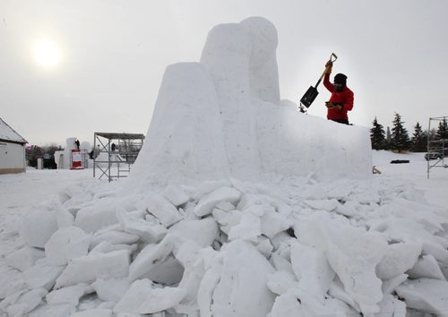 Snow sculptor Christine Chilcott from Sweden works on her creation at the Festival Du Voyageur - Western Canada's largest winter festival - the 2015 Festival du Voyageur - runs from February 13 – 22.-Standup Photo - Feb 12, 2015   (JOE BRYKSA / WINNIPEG FREE PRESS)