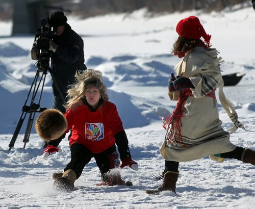 The Honourable Shelly Glover – Minister of Canadian Heritage and Official Languages, Government of Canada gets down to business Friday afternoon kicking a faux-fur covered soccerball around the Red River near the Forks. She and  The Honourable Peter MacKay – Minister of Justice, Government of Canada The Honourable Sharon Blady – Minister of Health, Province of Manitoba, Brian Bowman - Mayor of the City of Winnipeg, Ginette Lavack Walters – Executive Director of Festival du Voyageur were all taking part in an event promoting FIFA's upcoming women's event. See Randy Turner's story. February 13, 2015 - (Phil Hossack / Winnipeg Free Press)