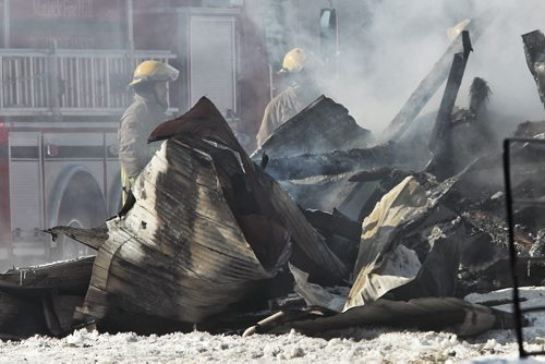 Firefighters continue to put out a barn fire at the Aesgard Ranch, located near Highway 8 in the R.M. of St. Andrews, 60 kilometres north of Winnipeg Sunday afternoon. Horses that were reported to have been housed in the now completely destroyed barn had been rescued and were not harmed by the fire.  150222 February 22, 2015 Mike Deal / Winnipeg Free Press