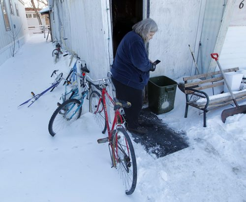 NEWS - KANE FIRE FOLLOW- MORDEN, MB - Beverley Eberhardt, grandmother to the 4 boys that died in the fire. Here she stands outside of her trailer home. On the left is some bicycles that the boys would ride when they were in town.  BORIS MINKEVICH/WINNIPEG FREE PRESS FEB. 26, 2015