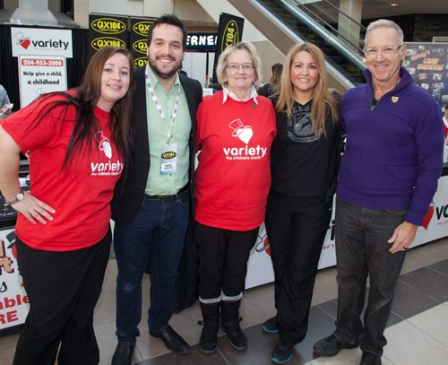 Variety, the Children's Charity of Manitoba, held its second annual QX 104 / FAB 94.3 Radiothon on Feb. 13, 2015 at Polo Park Shopping Centre. Pictured, from left, are Anna-Marie Gallos (Variety mother), Mike Hayes (QX 104), Norma Green (Variety volunteer), Karen Koutroubis (volunteer) and Louis Trepel (Variety international ambassador). (JOHN JOHNSTON / WINNIPEG FREE PRESS)