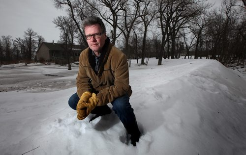 BRIAN WOLFE, spent $37,000 last summer building a dike around the back and sides of his 2-acre property to protect it from flooding from the nearby Assiniboine River. Now the province is talking about raising river levels by a further two and a half feet, which would mean his dike would have to be built even higher. He's seen on the dike surrounding his home. See Murray McNeil story. March 9, 2015 - (Phil Hossack / Winnipeg Free Press)