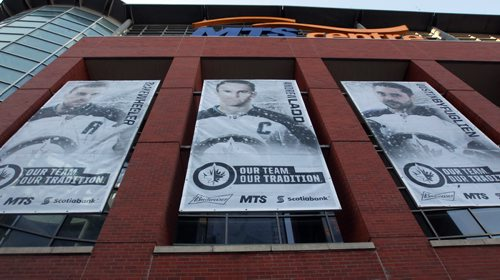 True North Sports and Entertainment hung new White Out playoff banners on the MTS Centre Friday morning after the Winnipeg Jets secured a Stanley Cup playoff berth last night- Standup Photo- Apr 10, 2015   (JOE BRYKSA / WINNIPEG FREE PRESS)