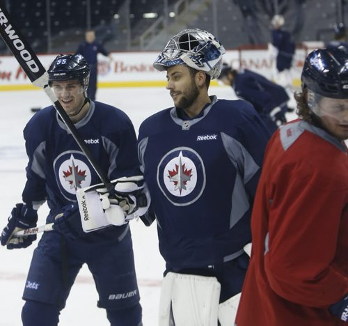 Winnipeg Jets goaltender  Ondrej Pavelec  and Mark Scheifele at the end of the practice in the MTS Centre Monday morning. Winnipeg Jets  face the Anaheim Ducks Monday night in Game 3 of their Western Conference First Round series.Wayne Glowacki/Winnipeg Free Press April 20 2015