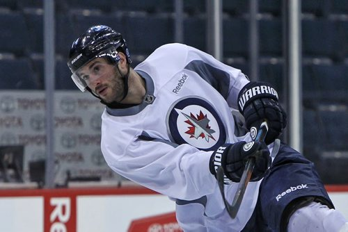 Winnipeg Jets' Anthony Peluso (14) during the morning pre-game skate at MTS Centre. The Jets will face-off against the Anaheim Ducks in the fourth game of their Stanley Cup playoff series tonight.   150422 April 22, 2015 Mike Deal / Winnipeg Free Press