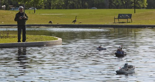 Dick Toews guides his tugboat Sunday morning at the Assiniboine Park Duck Pond.  Members of the Winnipeg Model Boat Club gather every Sunday morning (and Wednesday evenings) to sail their boats on the Duck Pond at the Assiniboine Park. The radio operated boats range from kits you can order online to ones made from scratch. The club will be holding its 2015 Boat Regatta at the Duck Pond on Sunday, June 21st from 8AM - 4PM. 150524 May 24, 2015 Mike Deal / Winnipeg Free Press