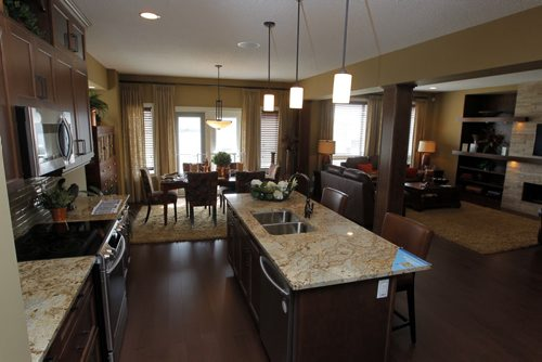 HOMES - 60 Dana Crescent in Amber Trails - Main floor kitchen dining room living room.  BORIS MINKEVICH/WINNIPEG FREE PRESS May 25, 2015