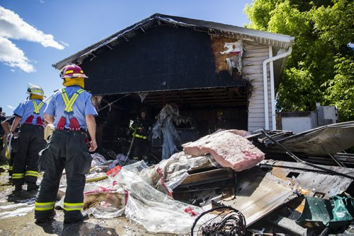 A garage fire at 703 Burrows Avenue in Winnipeg on Thursday, June 18, 2015.  Nobody appeared to be injured, but children in a day home were evacuated. Mikaela MacKenzie / Winnipeg Free Press
