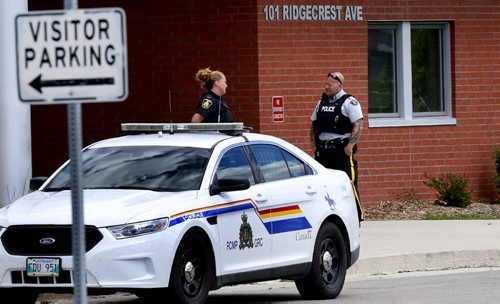 Winnipeg Police and RCMP officers outside the West Kildonan Collegiate Thursday afternoon. The RCMP issued a release stating that at approximately 8:30 pm Wednesday, East St. Paul RCMP received a report of a missing male youth from the RM of West St. Paul, Manitoba. Nicholas Read, 16, is autistic and police are worried for his well-being. Nicholas was last seen at 7:30 am on June 17, 2015, when he was dropped off at West Kildonan Collegiate by his father. When Nicholas did not return home on the school bus, his family went looking for him. Nicholas had not attended any of his classes.   Kevin Rollason story Wayne Glowacki / Winnipeg Free Press June 18  2015