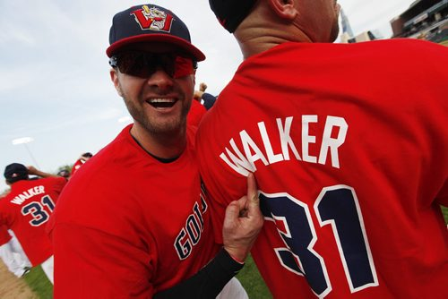 June 23, 2015 - 150623  - Winnipeg Goldeyes' Josh Mazzola (13) points to the Ace Walker jersey the team wore during a celebration to retire Walker's jersey before their game against the Gary Southshore Railcats in Winnipeg Tuesday, June 23, 2015. John Woods / Winnipeg Free Press