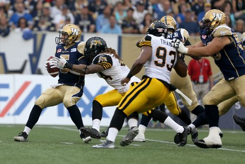 Hamilton Tiger-Cats'  Taylor Reed (44) and Ted Laurent (97) sack Winnipeg Blue Bombers' quarterback Drew Willy (5). Willy would be hurt on the play and be forced to leave the game. Thursday, July 2, 2015. (TREVOR HAGAN/WINNIPEG FREE PRESS)