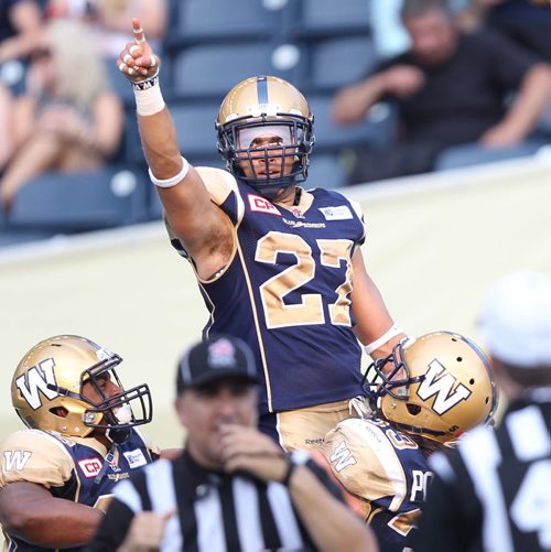 Tegue Sherman celebrates touchdown  after Winnipeg Blue Bomber Lin J Shell , not pictured, blocked a punt against the Montreal Alouettes during first half CFL action in Winnipeg Friday night- The Bombers went on to score to take a 19-10 lead at the half -See Paul Wiecek story- July 10, 2015   (JOE BRYKSA / WINNIPEG FREE PRESS)