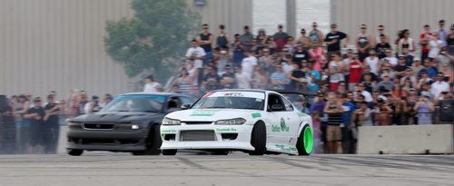 Matt Murphy, from Fort McMurray, Alberta, and Chris Gonzalez, from Winnipeg, drifting during a Formula D Canada demo at the Red River Ex Grounds during Driven, a car show, Saturday, July 11, 2015. (TREVOR HAGAN/WINNIPEG FREE PRESS)