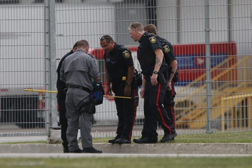July 14, 2015 - 150714  -  Police take a look at what was taken out of the suspicious package building at the rear of the Canada Post building. The Canada Post building at the airport was evacuated because of a suspicious package Tuesday July 14, 2015.  John Woods / Winnipeg Free Press
