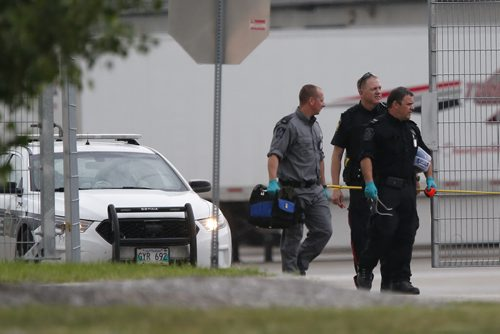 July 14, 2015 - 150714  -  Police leave the Canada Post building after checking out a suspicious package. The Canada Post building at the airport was evacuated because of a suspicious package Tuesday July 14, 2015.  John Woods / Winnipeg Free Press
